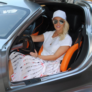 Supercar Blondie Waves the Checkered Flag