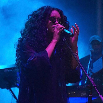 Experience the Enigmatic Presence of H.E.R.